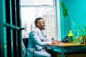 loan-processor-sitting-at-desk