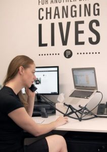 Image of woman on the phone at desk